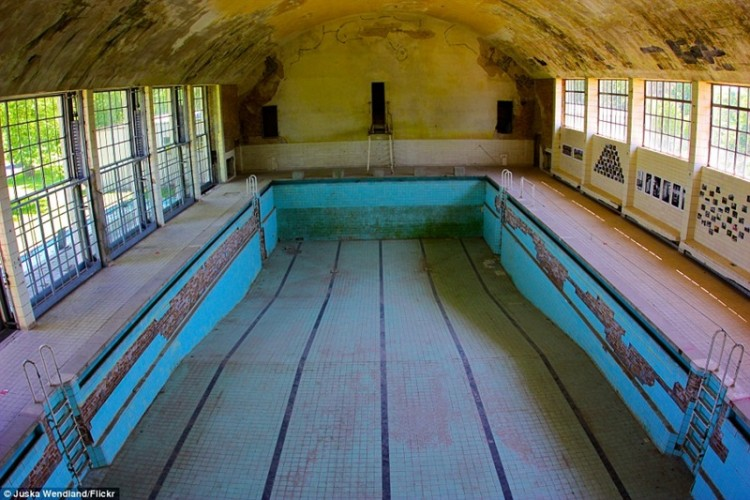This swimming pool from the 1936 Olympic village in Elsral, west of Berlin, has been completely drained and has filled with sand and dirt from the peeling ceiling