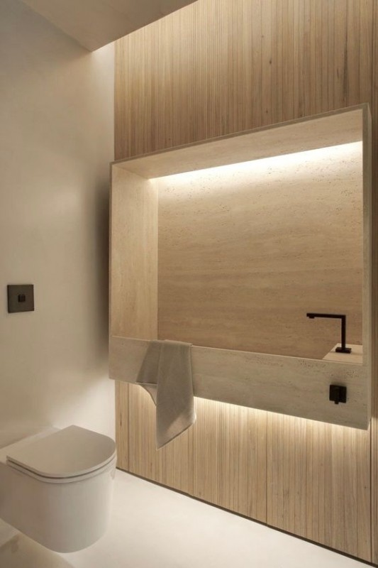 Uma solução interessante para um lavabo bem estreito, com a bancada com a cuba esculpida.